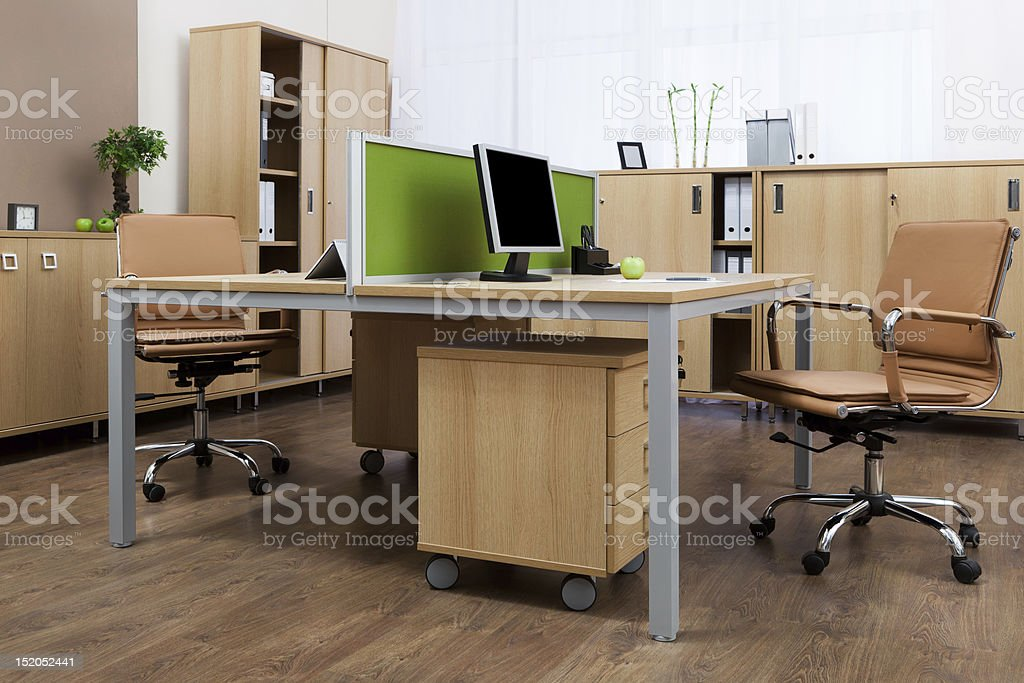 An office space for two with brown chairs and cabinets stock photo