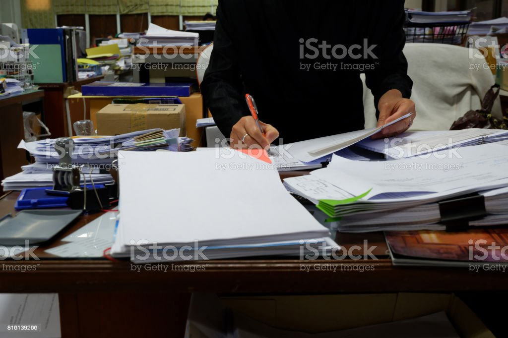 An officer is working in messy workplace. stock photo