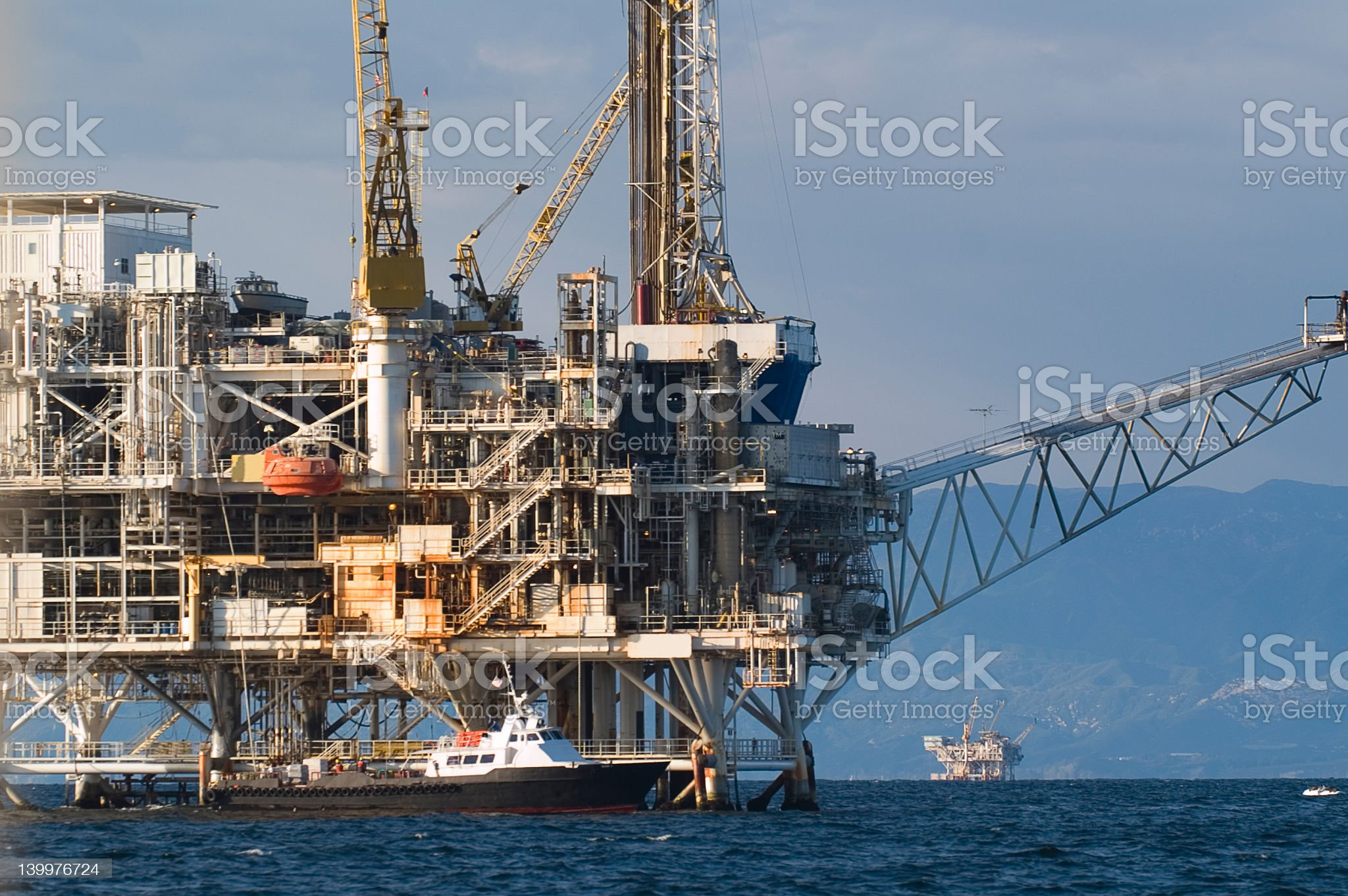 An oil drilling rig in the middle of the ocean royalty-free stock photo