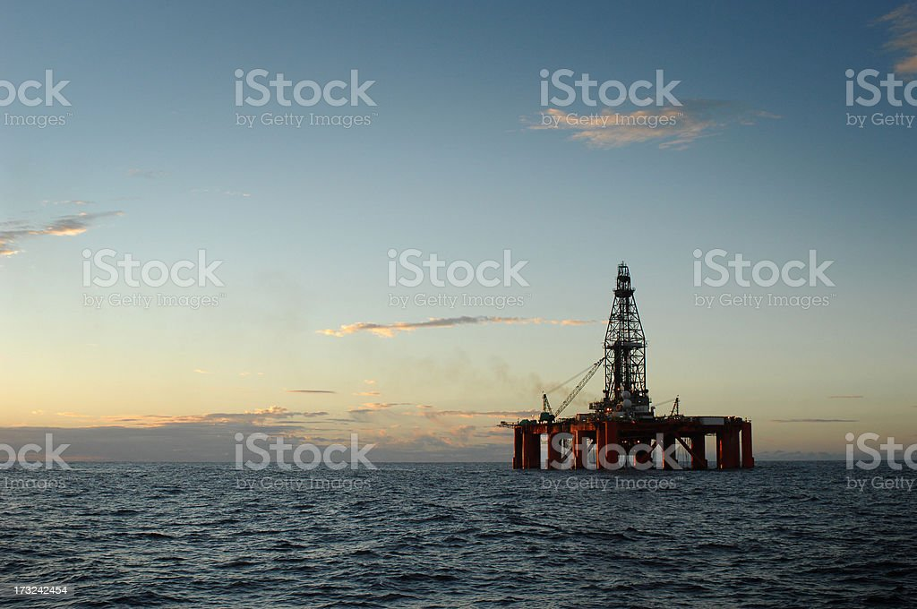 An oil rig in the ocean stock photo
