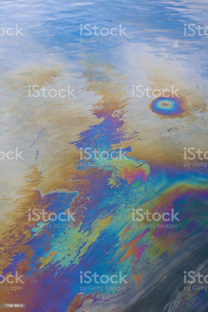An oil slick blemishing an ocean stock photo