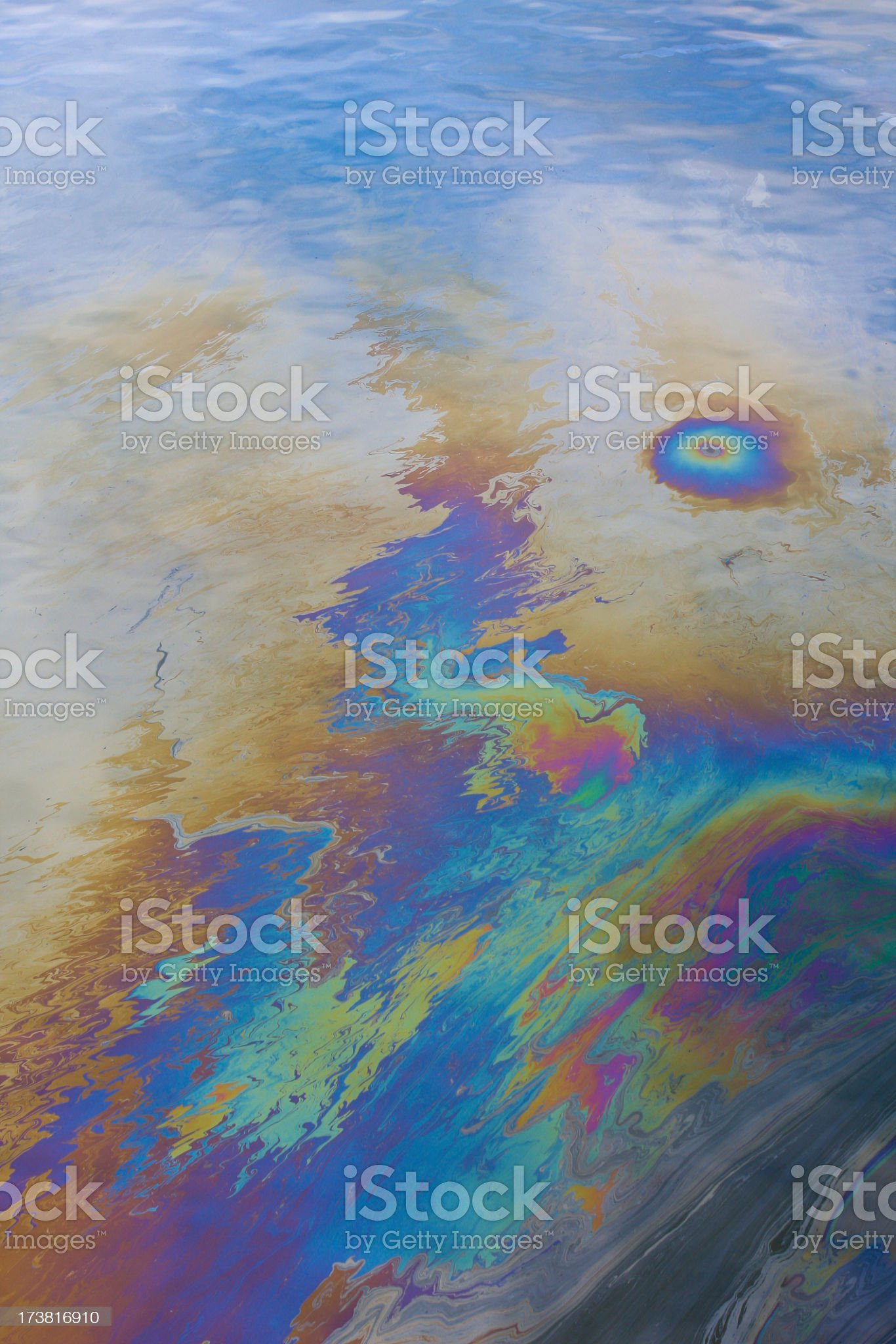 An oil slick blemishing an ocean royalty-free stock photo