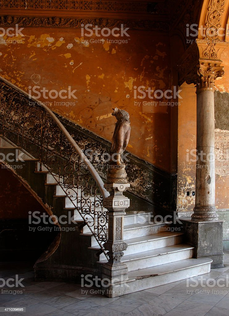 An old abandon house with broken statue and scratched wall royalty-free stock photo