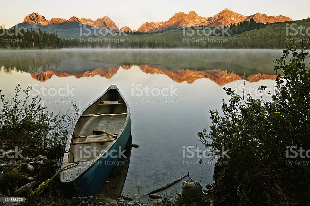 An old boat looking out into the Sawtooth sunrise stock photo