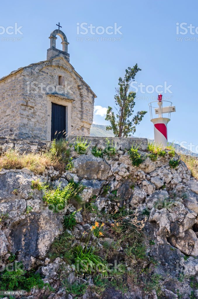An old chapel and a light tower in Kotor, Montenegro stock photo