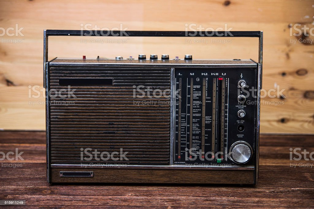 An old dark brown radio on wood table. stock photo