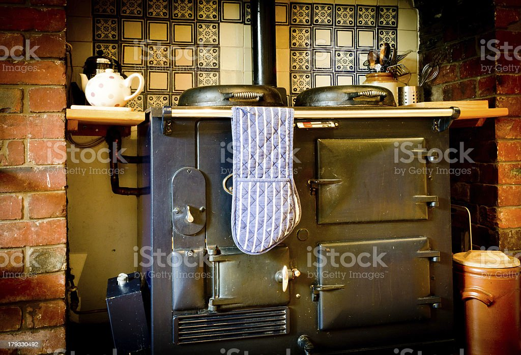 An old fashioned Aga style stove to add flare to an old room stock photo