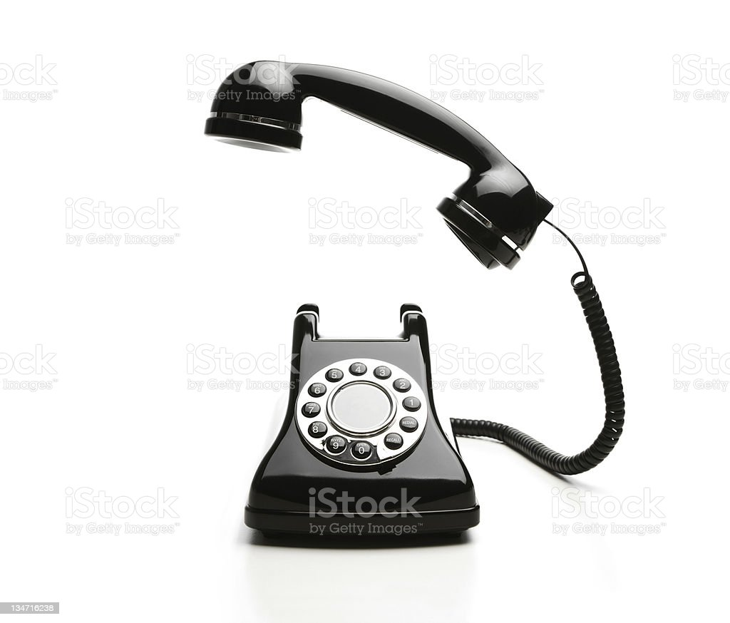 An old fashioned telephone with the phone of the hook stock photo