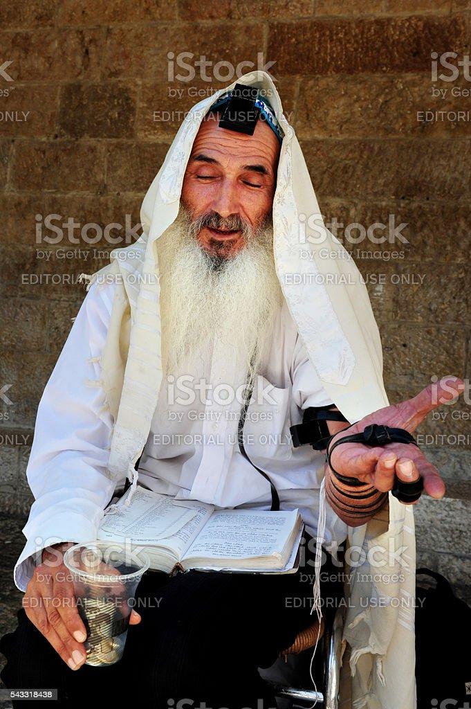 An old Jewish orthodox man begging for tzedakah stock photo