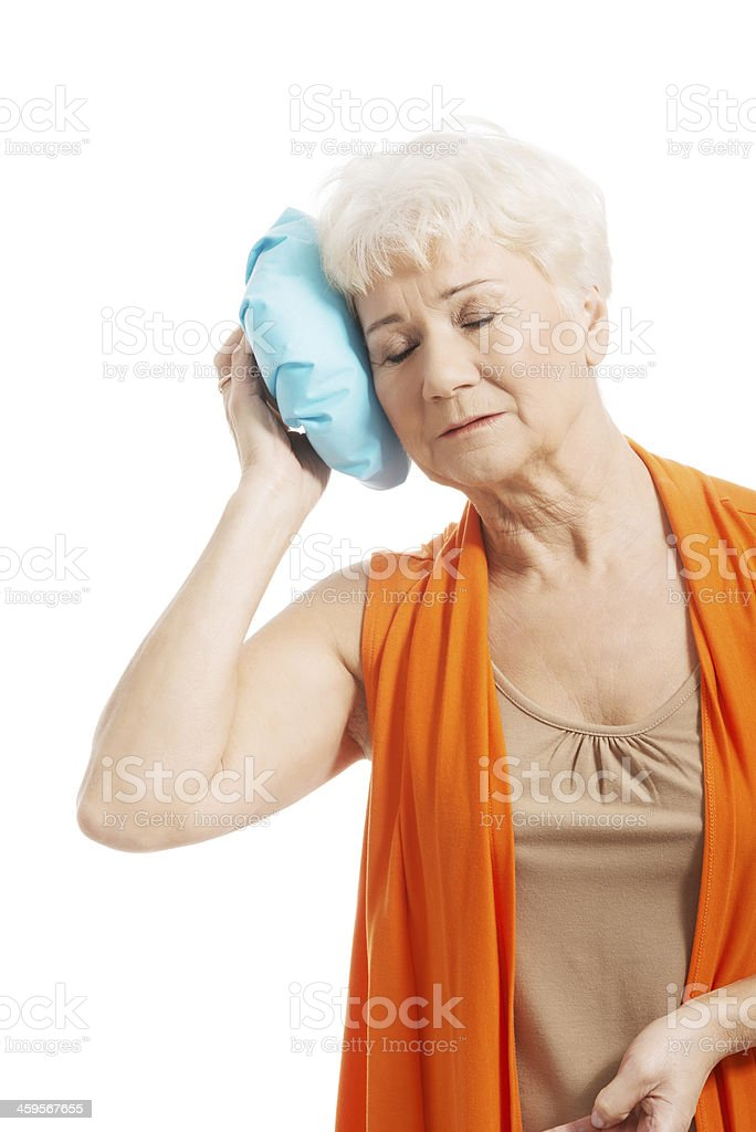 An old lady with ice bag by her head. royalty-free stock photo
