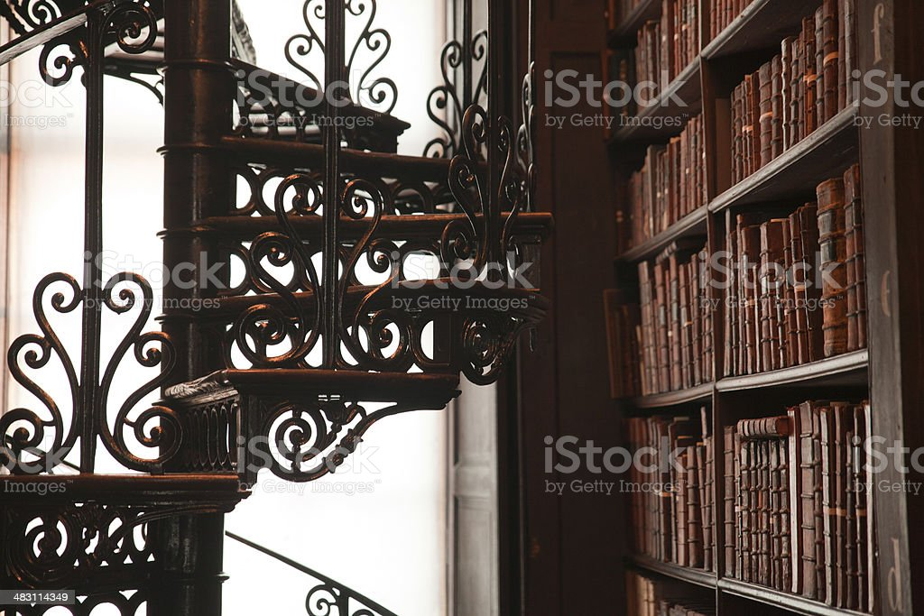 An old library full of old and rare texts with an old floor stock photo