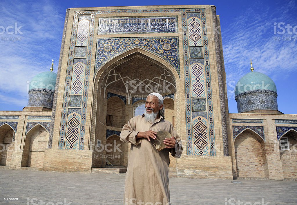 An old man outside a Mediterranean style building stock photo