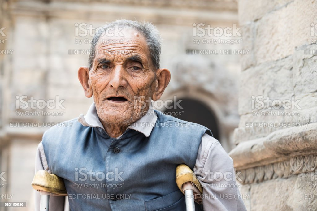 An old man with crutches. stock photo