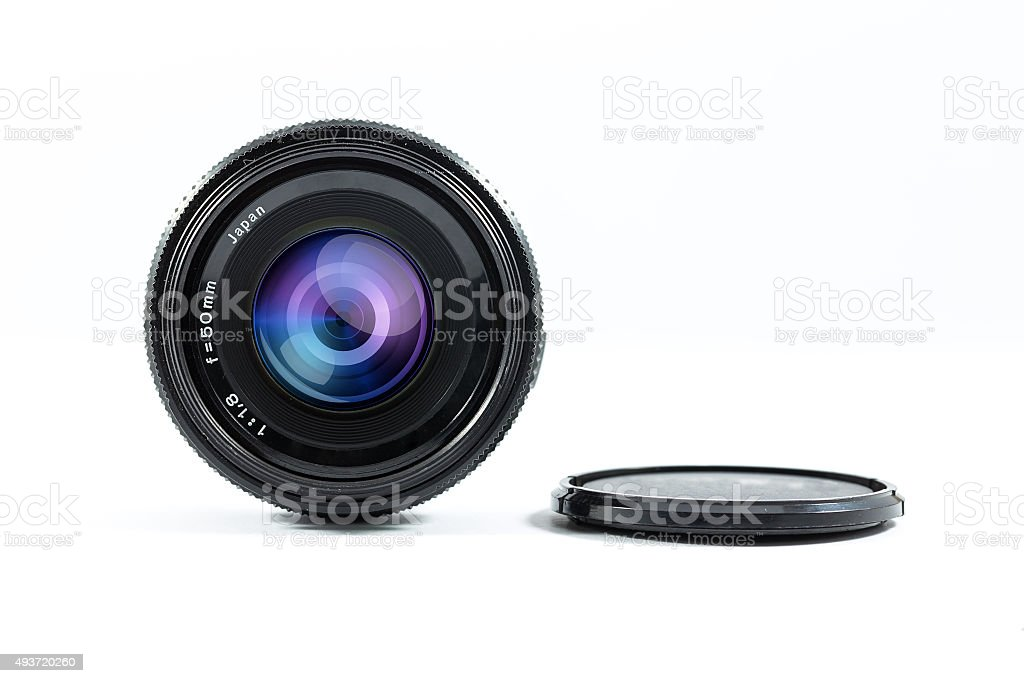 An old manual control camera lens isolated on white. stock photo