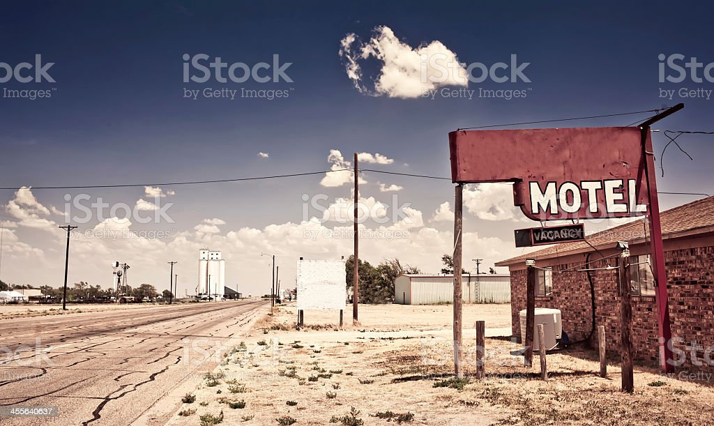 An old motel on a dirt road in the middle of nowhere stock photo