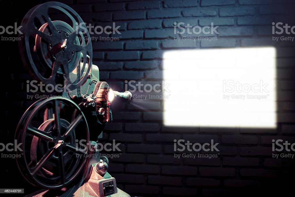 An old movie projector on the wall stock photo
