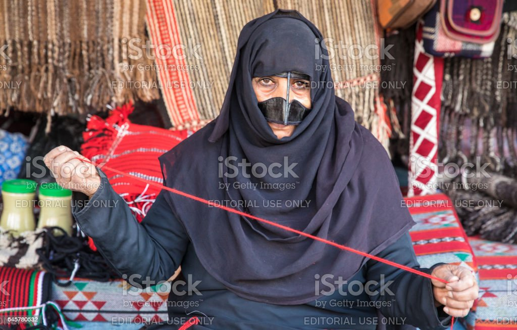 An old Omani woman on a market. stock photo