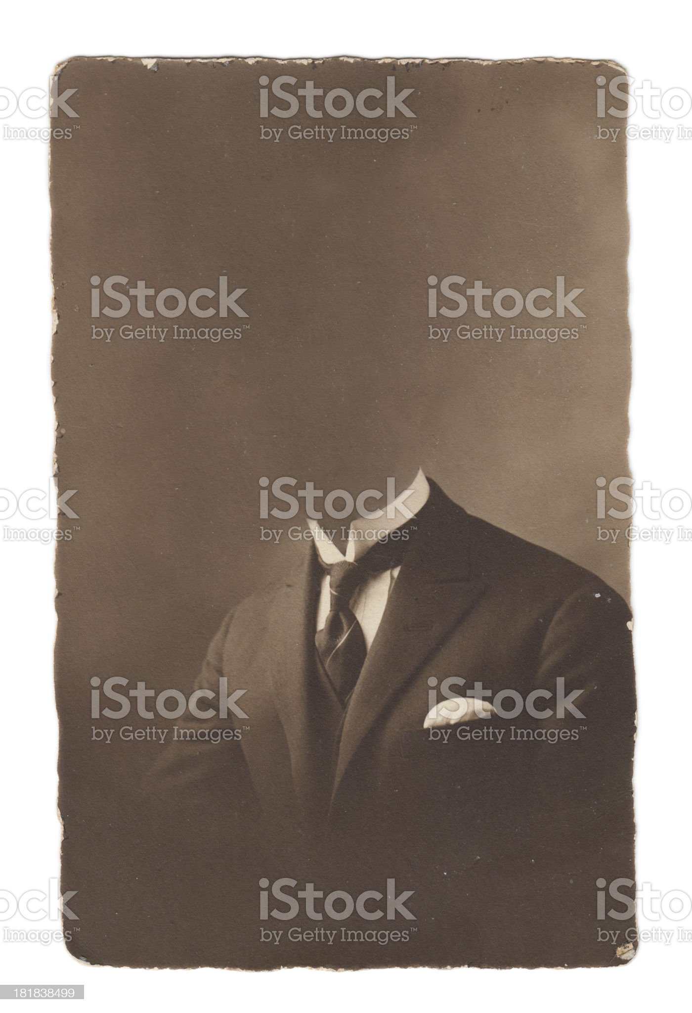 An old photograph of a man in a suit missing his head royalty-free stock photo
