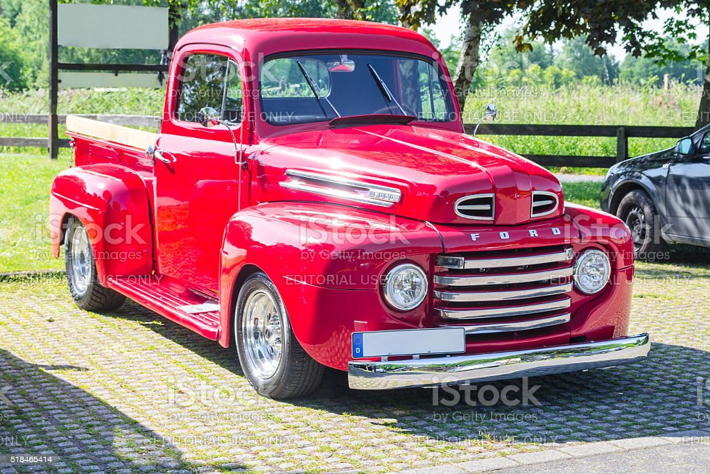 An old renovated red Ford vintage pickup stock photo