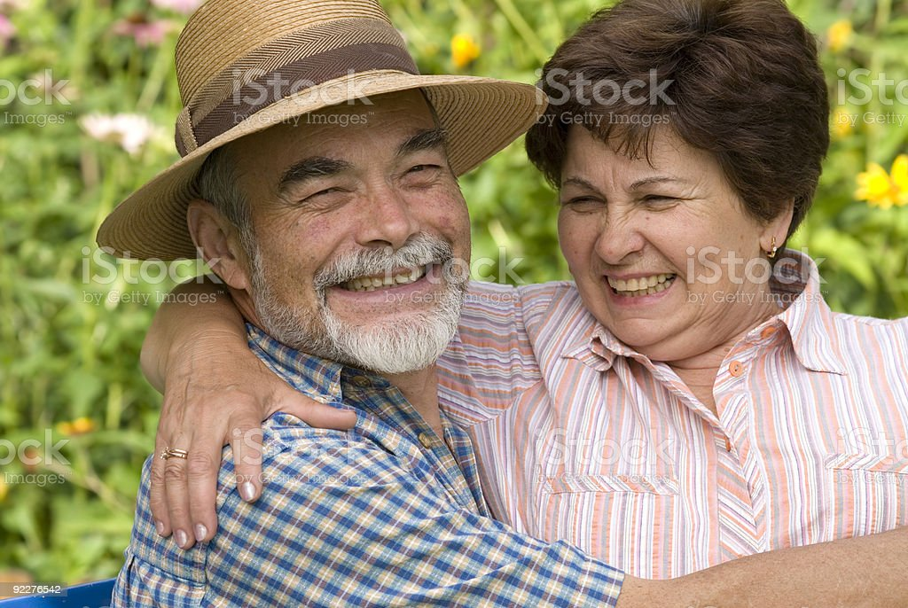 An old romantic couple embracing each other royalty-free stock photo