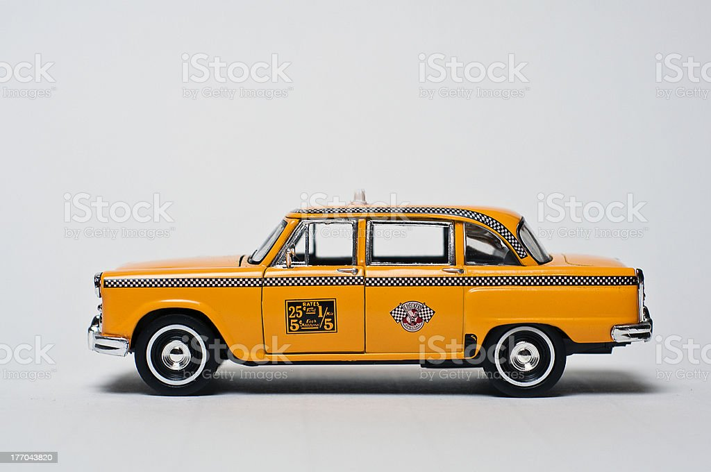 An old school yellow taxi against a white background stock photo