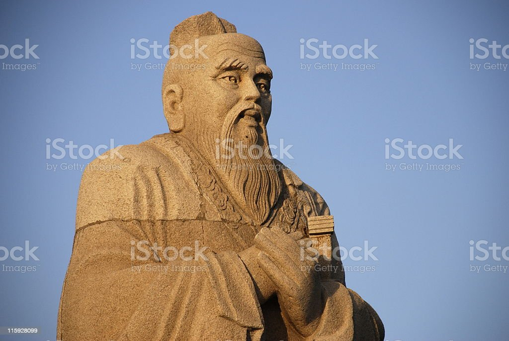 An old stone statue of Confucius stock photo