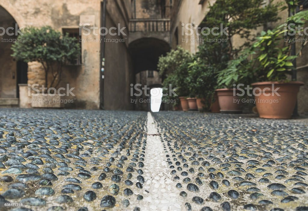 An old street in Porto Maurizio, Imperia, Italy stock photo
