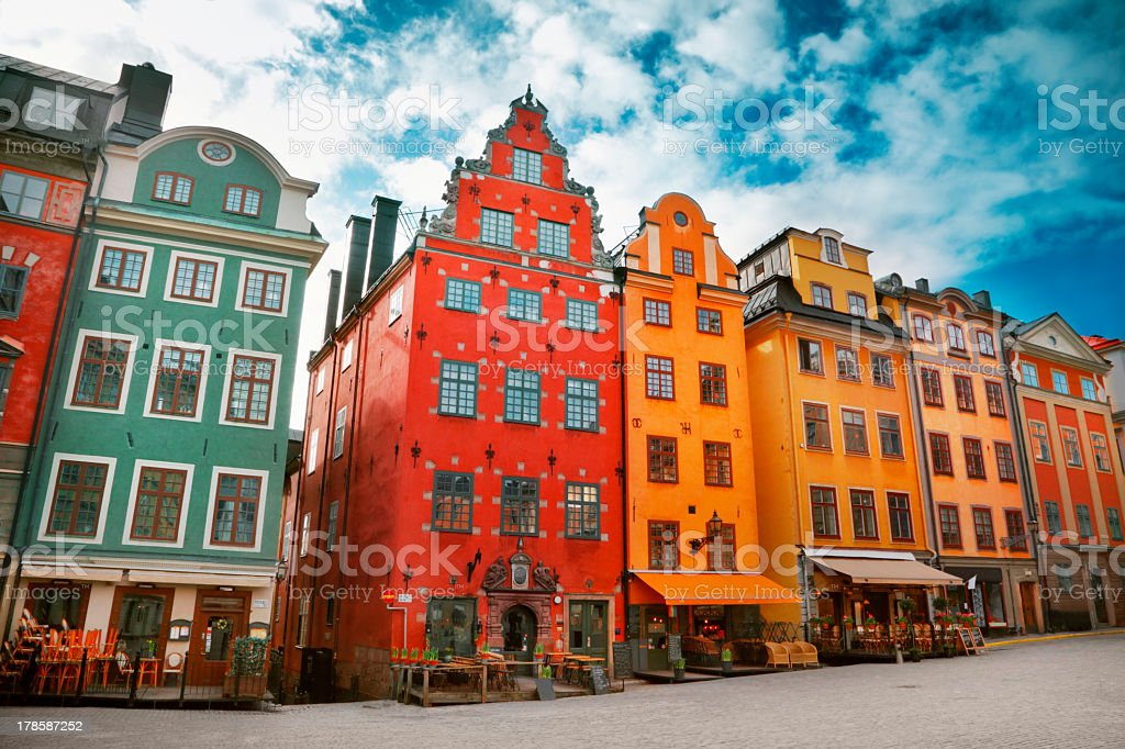 An old town with colorful buildings in a row stock photo