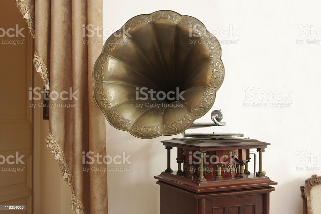 An old vintage gramophone on a brown table royalty-free stock photo