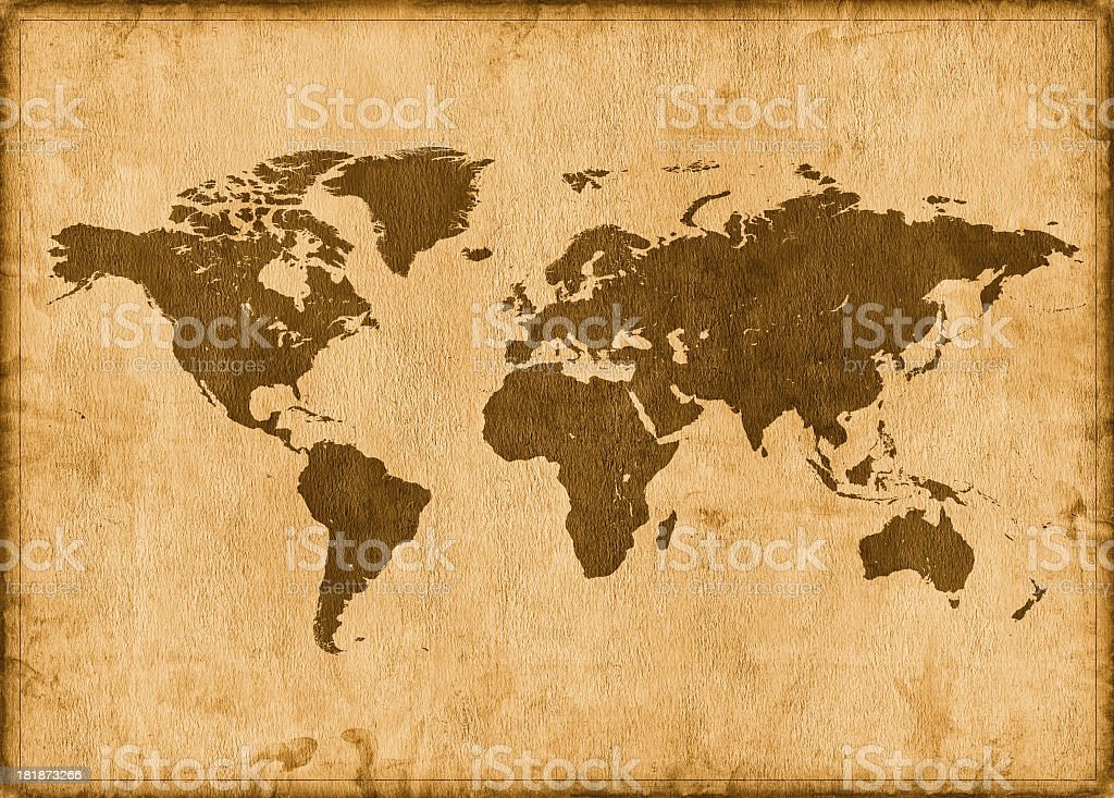 An old vintage world map with yellowish color stock photo