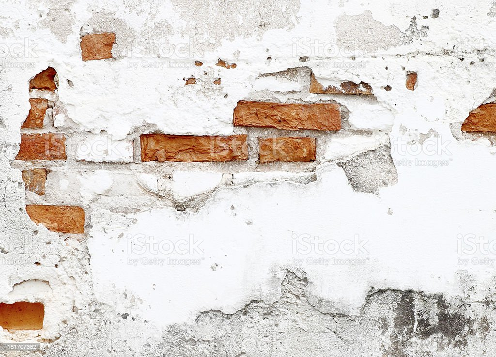 An old worn down red brick wall royalty-free stock photo
