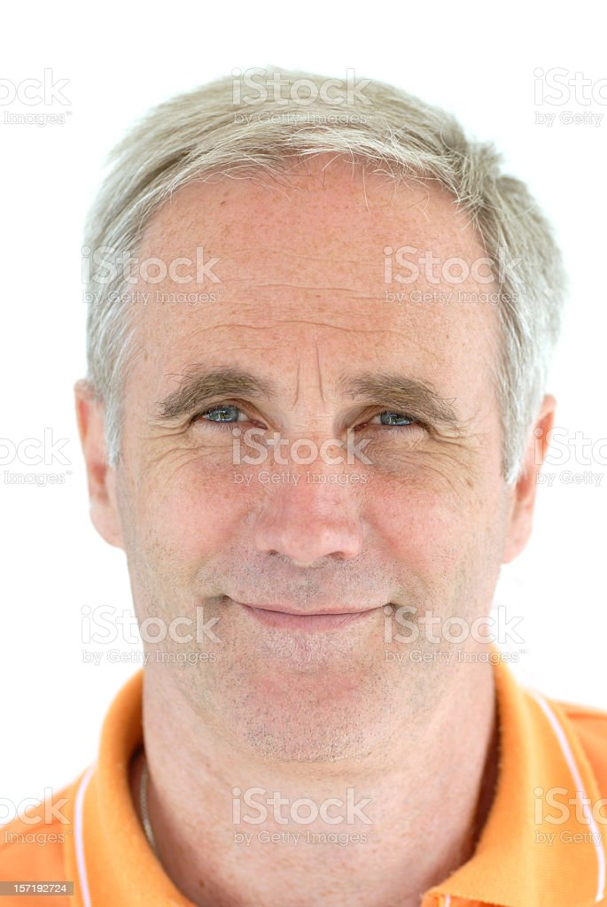 An older man smiling at the camera with a white background royalty-free stock photo