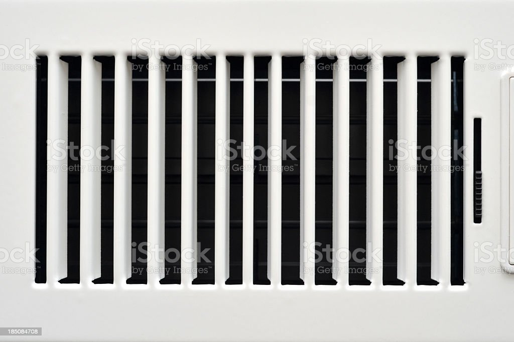 An opaque white heating vent opened stock photo