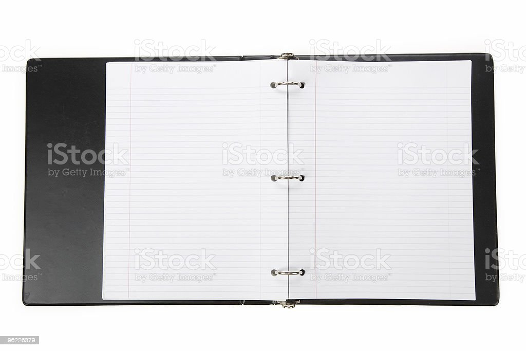 An open binder with blank looseleaf paper stock photo