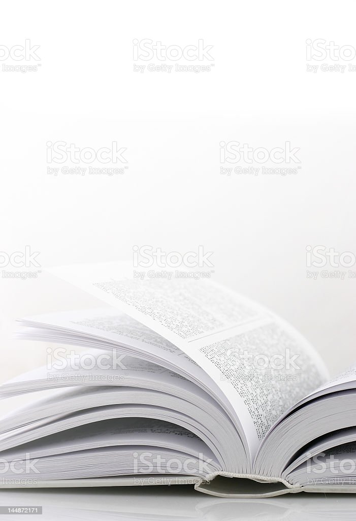 An open book on white background royalty-free stock photo