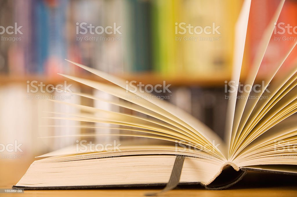 An open book with a leather bookmark stock photo