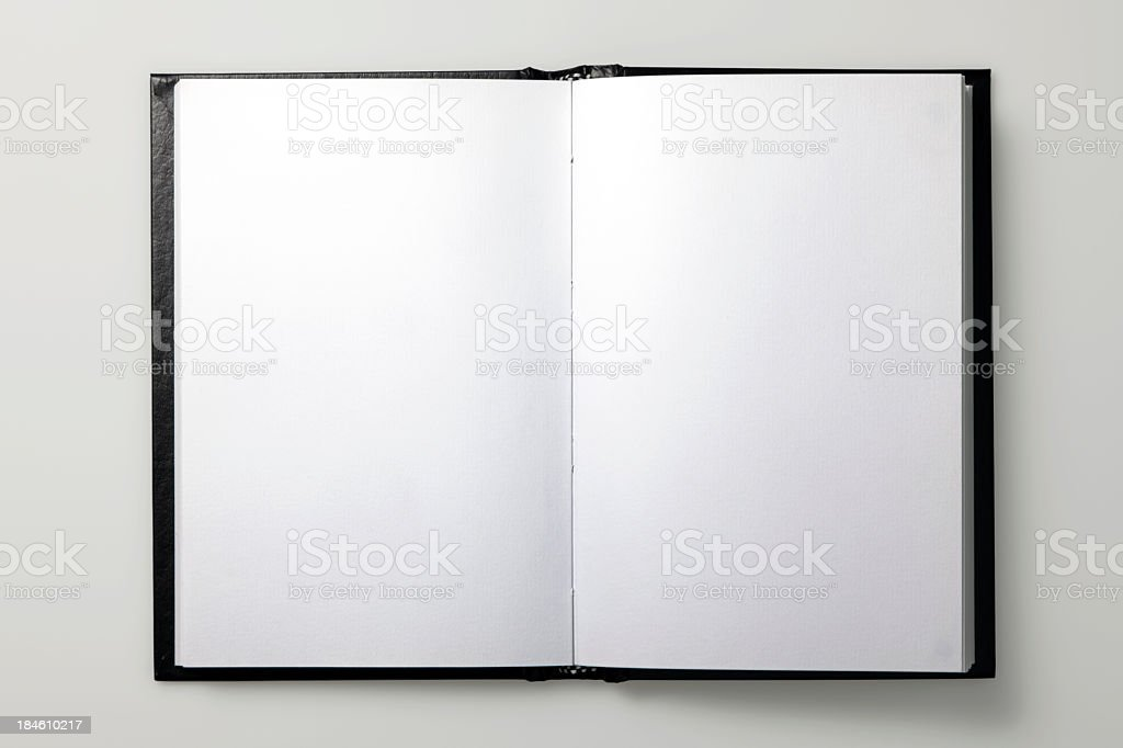 An open book with black pages on a white background royalty-free stock photo
