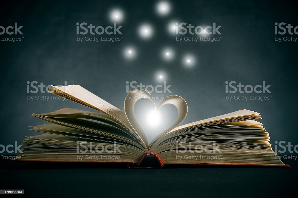 An open book with its pages folded into a heart royalty-free stock photo