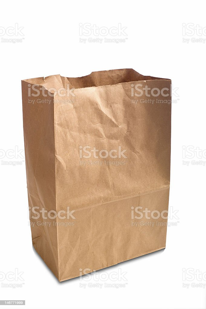 An open brown paper bag on a white background stock photo