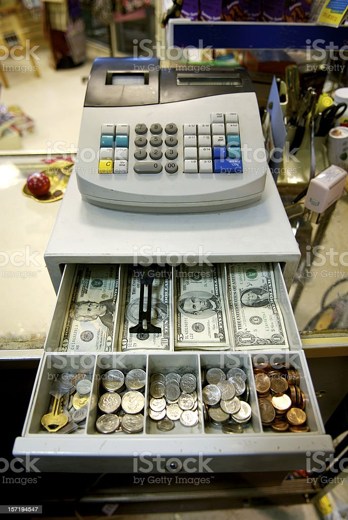 An open cash drawer showing bills and coins royalty-free stock photo