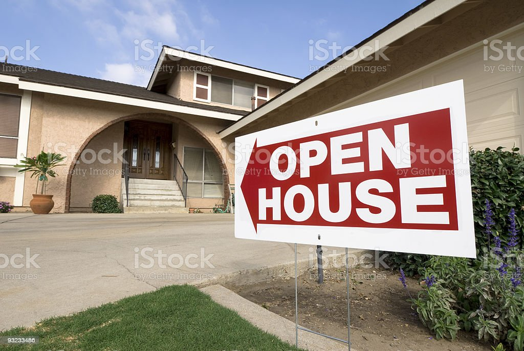 An open house sign outside a house stock photo