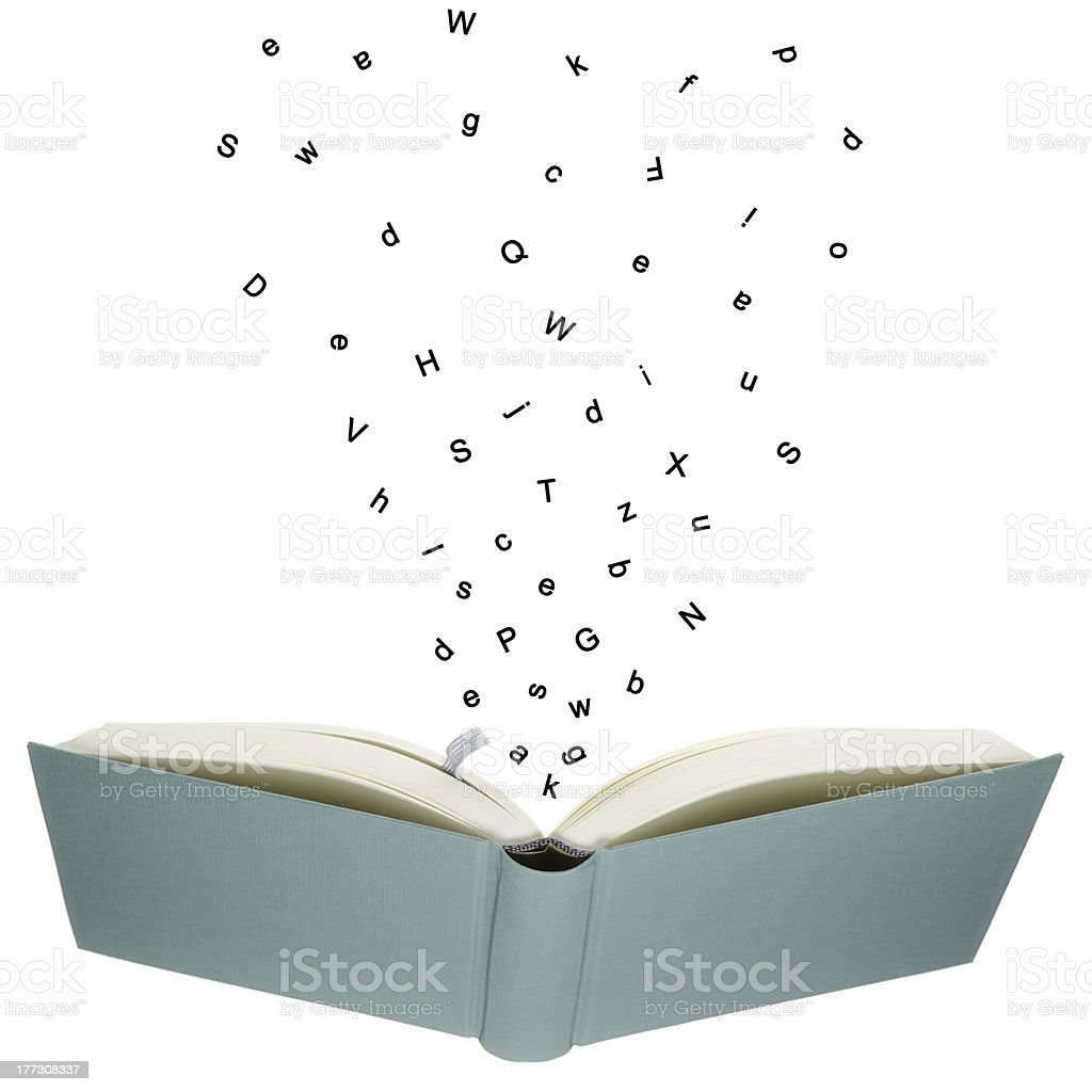 An opened book with 3D letters flying stock photo