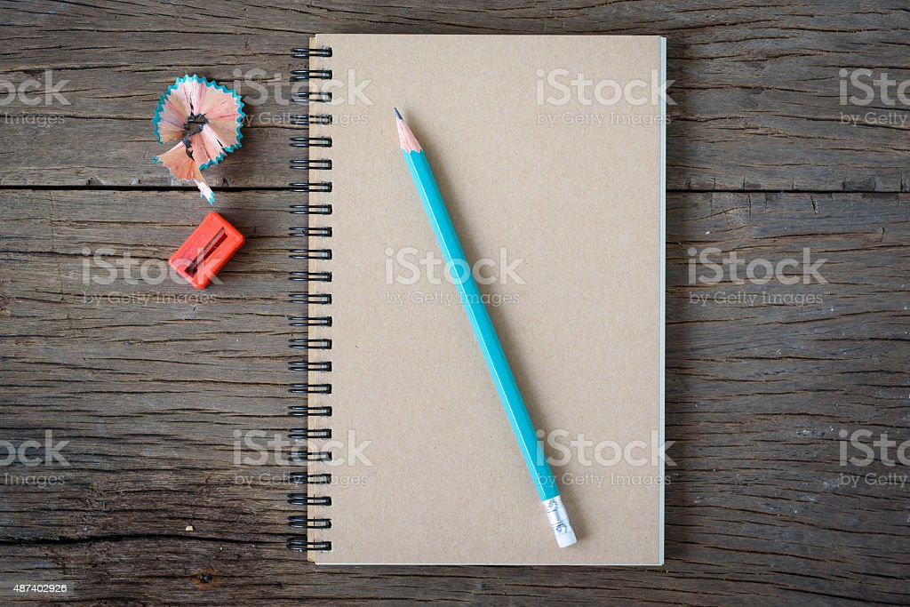 An opened notebook with pencil stock photo