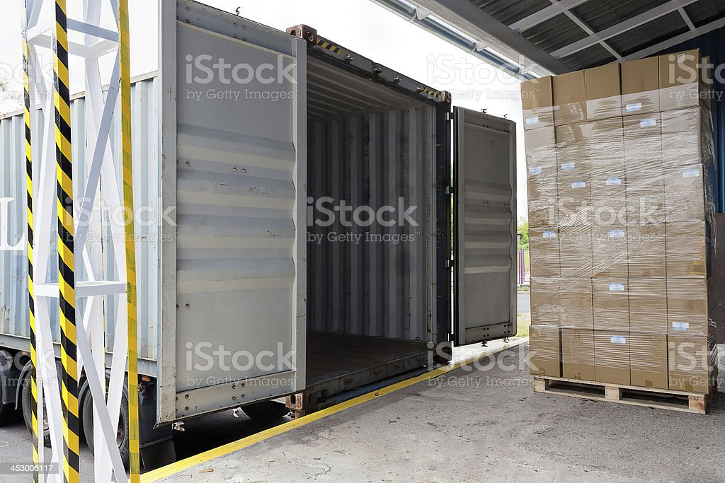 An opened truck on a loading dock stock photo