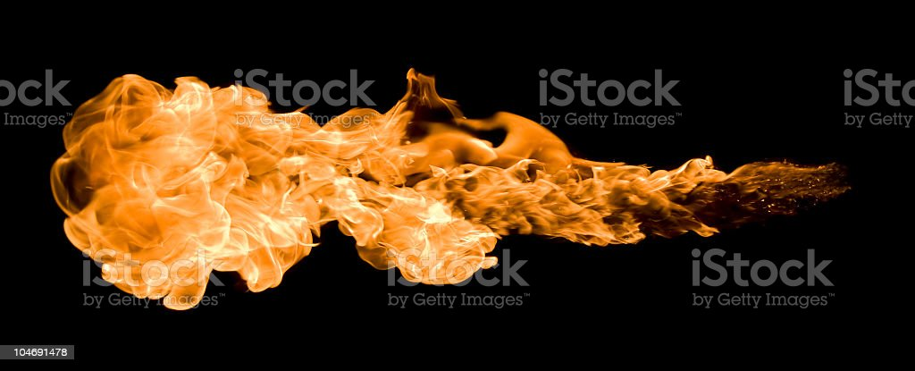 An orange blazing fire ball across a black background stock photo