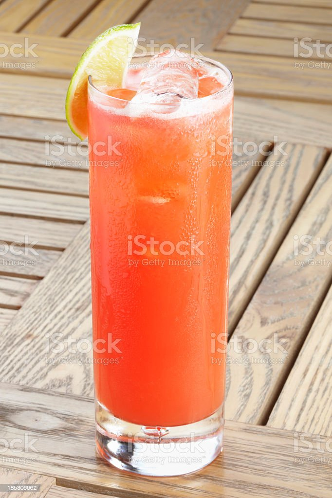 An orange cocktail on a wooden table  stock photo