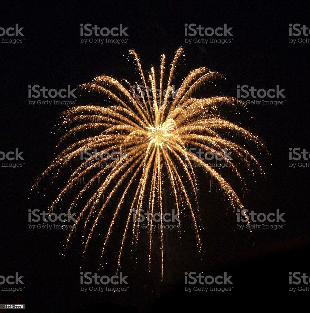 An orange colored firework burst stock photo