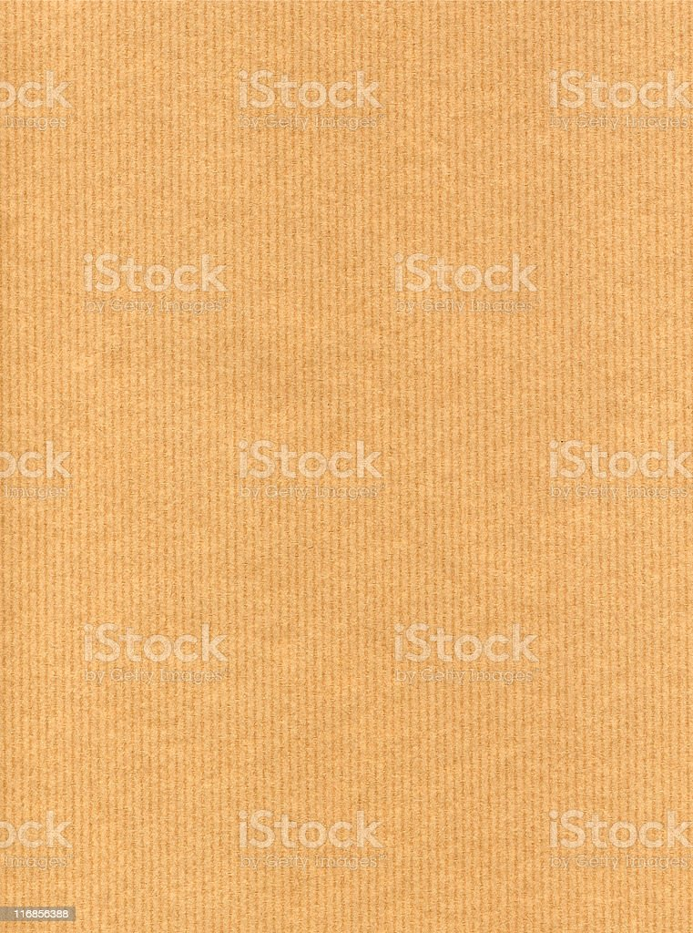 An orange paper background with narrow vertical stripes royalty-free stock photo