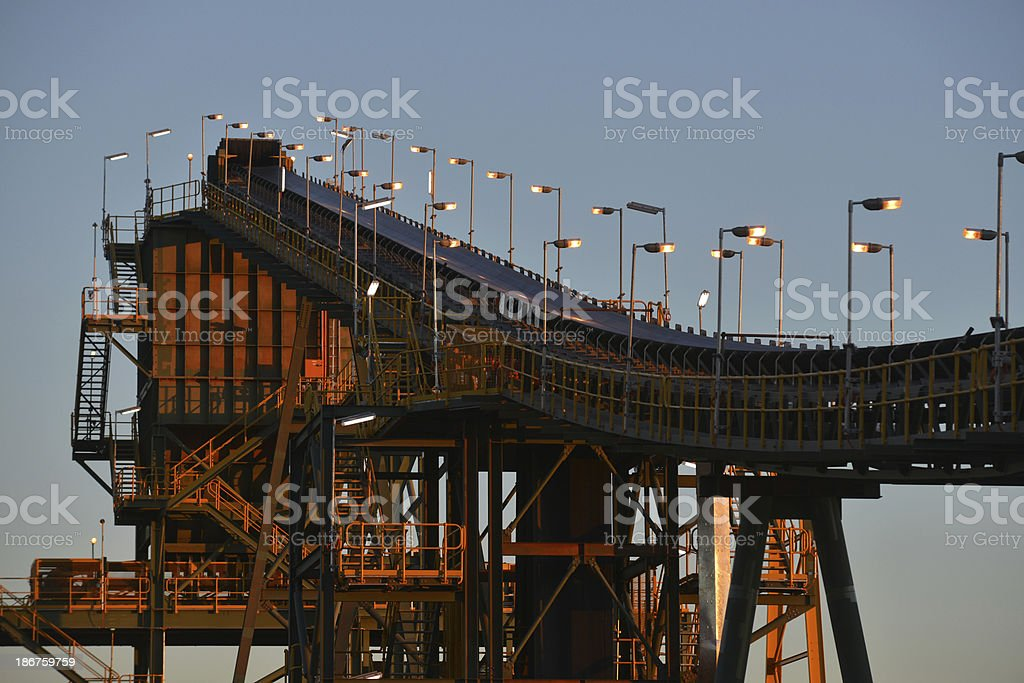 An ore processing plant at dusk under a clear sky royalty-free stock photo