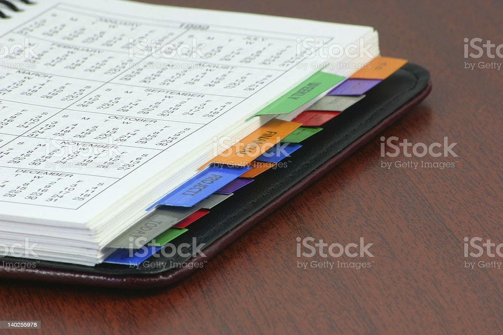 An organizer with colorful dividers lying on a desk stock photo